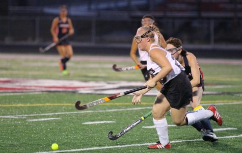 Junior Karina Steitz fights to move the ball down the field to help her team score.