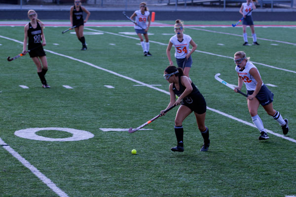 Sarah Smith moving the ball up the field.