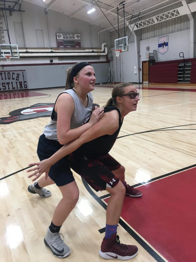 Junior+Samantha+Brown+%28right%29+boxes+junior+Kaitlynn+Stay+%28left%29+to+keep+her+from+getting+the+rebound.