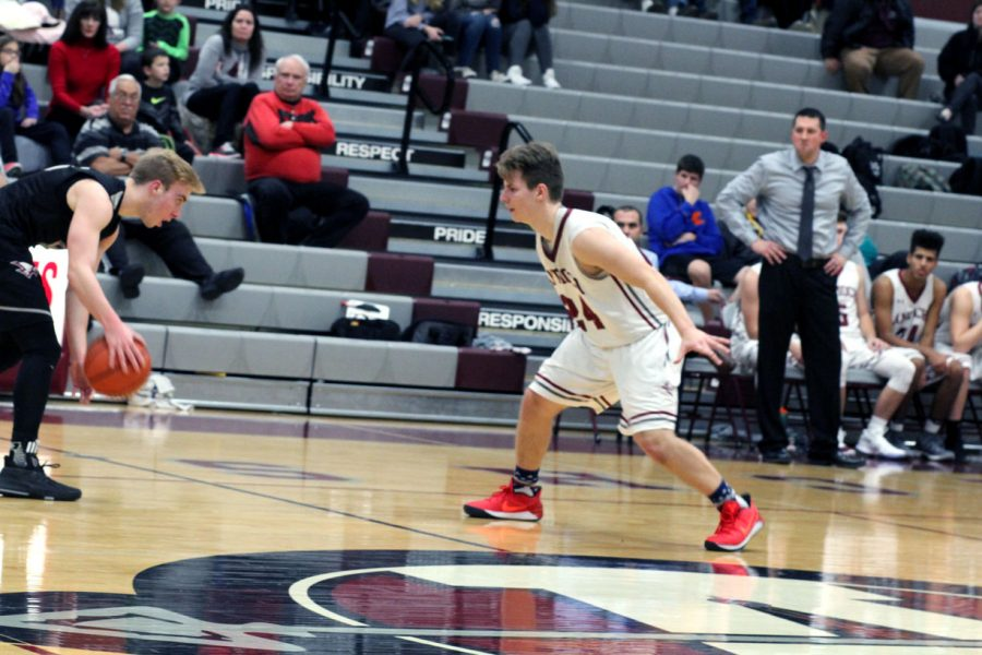 Dan Filippone plays lock down defense against the Westosha Falcons' guard.
