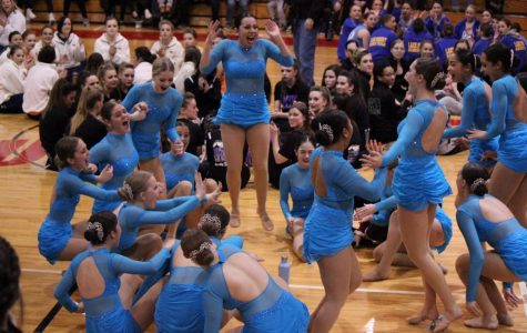 The dance team cheers with joy as they were named sectional champions