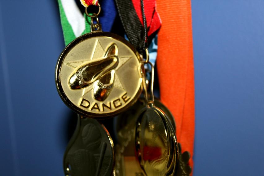 A medal that the dance team won