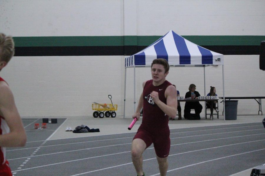Junior Mikey Volkmar runs in the conference meet.