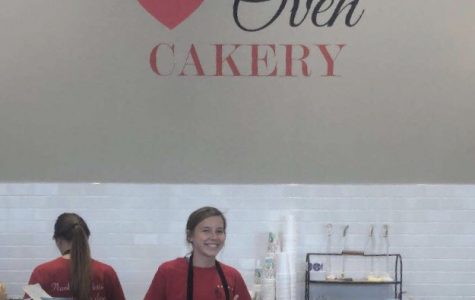 Lily Highley smiles behind the front counter at Lovin' Oven Bakery.