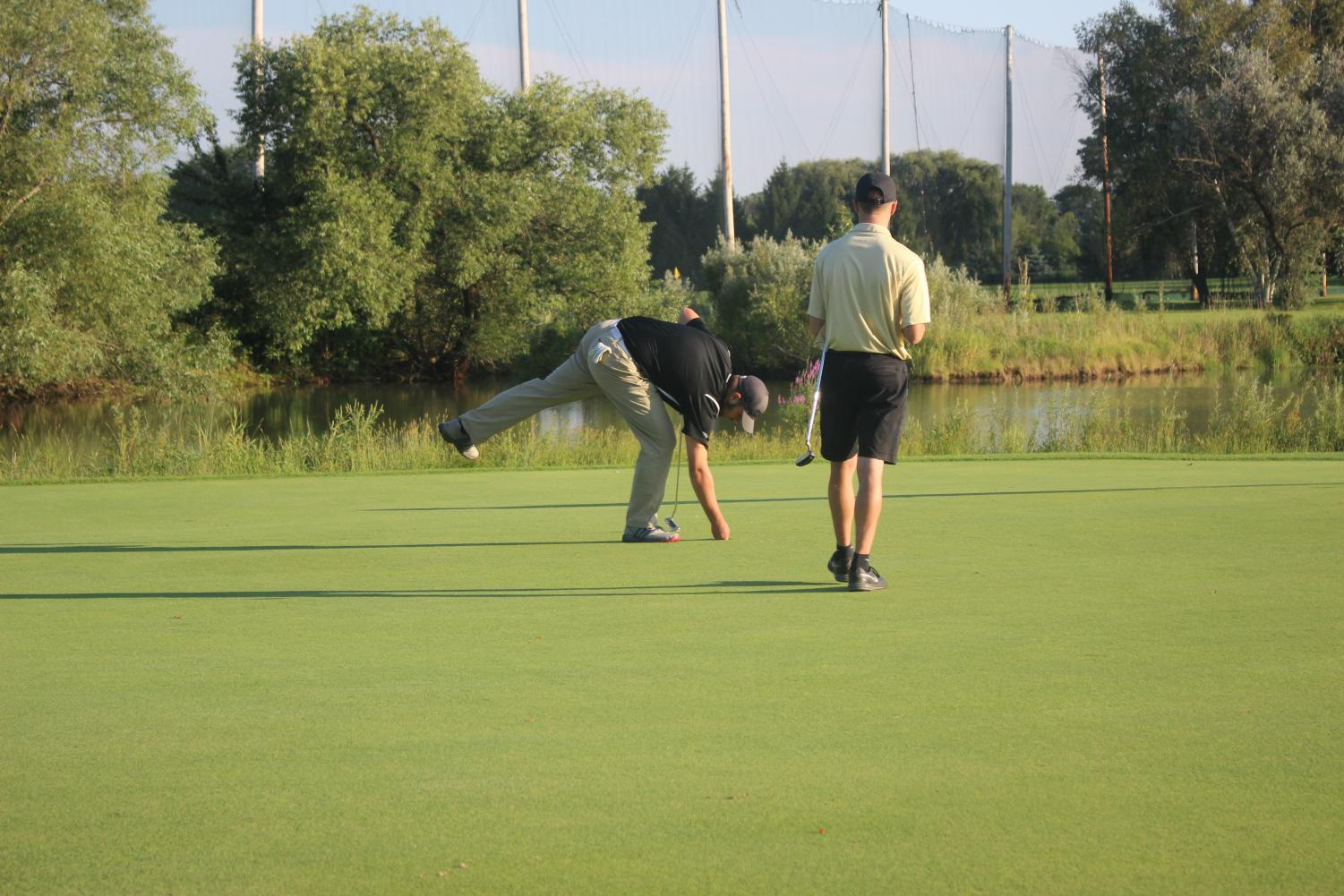 Tony Sertic makes a putt to win the match.