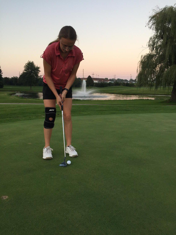 Samantha brown prepares to hit her putt.