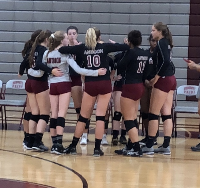 The+girls+varsity+volleyball+team+gets+ready+for+their+game+against+the+Warhawks.