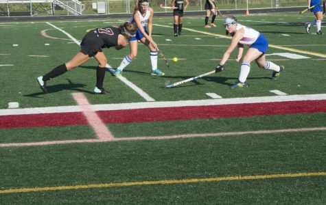 The Antioch field hockey team pushes forward to try and win the ball.