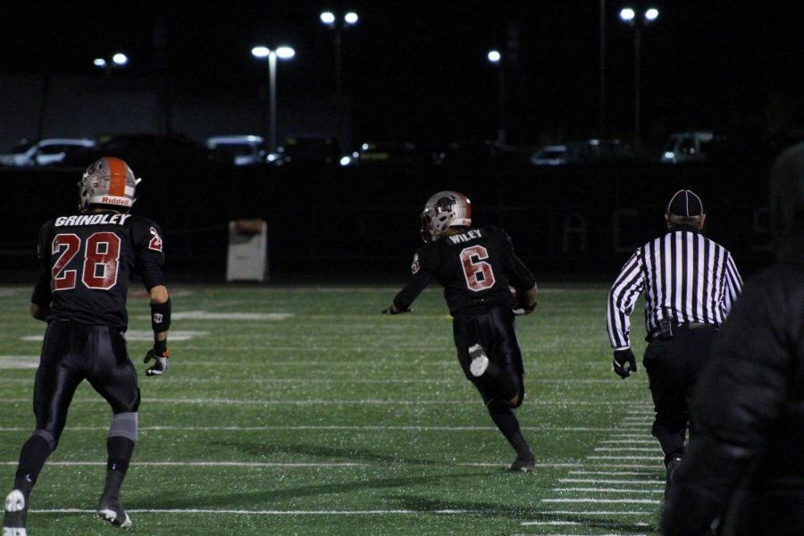 Senior running back Nick Wiley runs the ball back from a kick return to score a Sequoit touchdown.