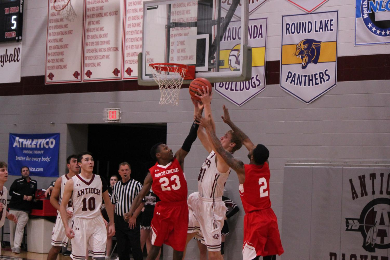 Senior Kevin Tebbe goes for a layup against the Warhawks.