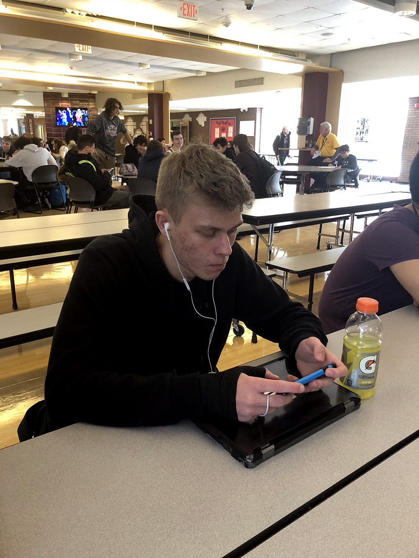 Senior Braden Buehlman spends his time playing on his phone instead of getting homework done for his next period class