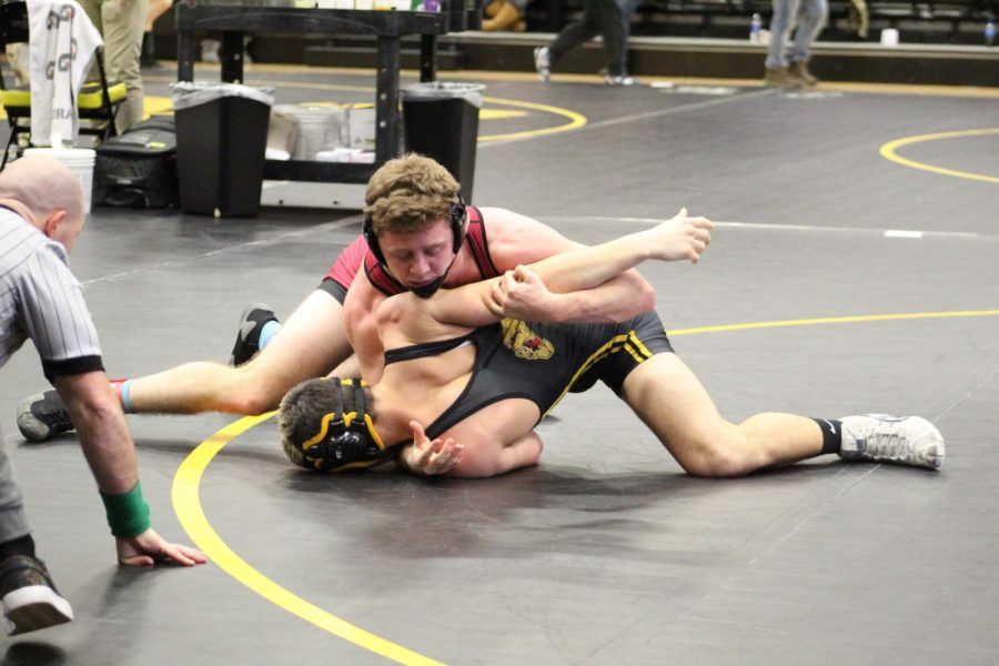 Senior+Michael+Volkmar+takes+down+and+attempts+to+pin+his+opponent+from+Bettendorf%2C+Iowa.