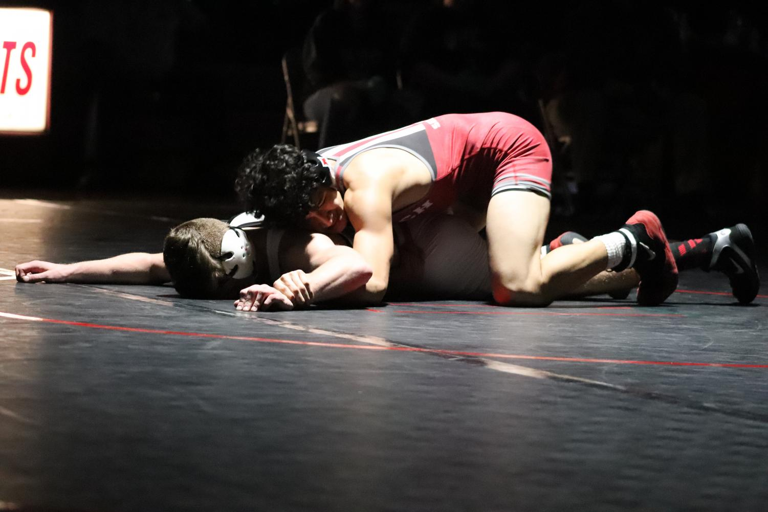 Elijah Reyes pins the competition on his way to state.