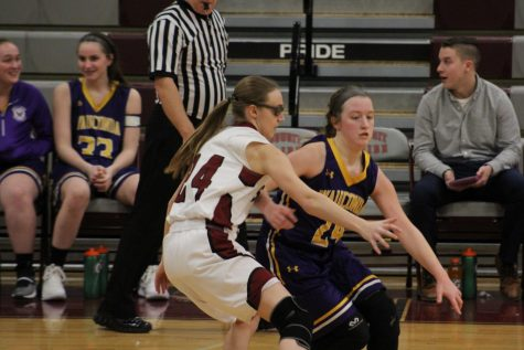 Senior Samantha Brown guards her opponent.