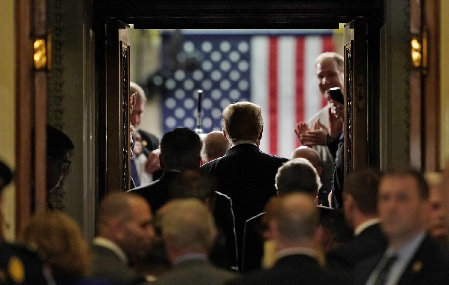 Carolyn Kaster takes a photo of Trump at his 2019 State of Union Address.