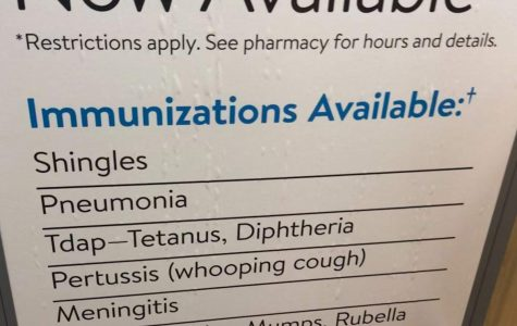 The Walmart pharmacy displays types of vaccines a person can get for different illnesses.