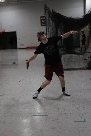 Senior Matt Becker practices discus throw