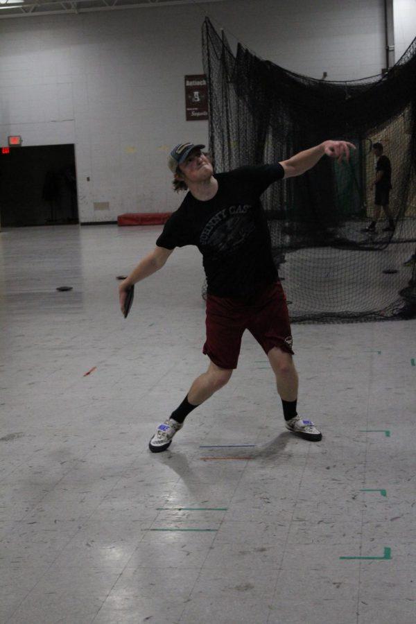 Senior Matt Becker practices discus throw