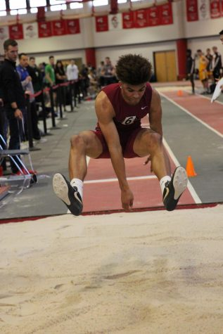 Junior Tre Watson looks to reach a person record in the long jump.