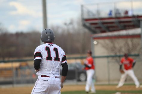 Varsity Baseball Crushes McHenry