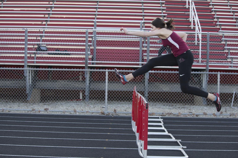 Jada Shaputis runs the hurdles at the Sequoits home track.