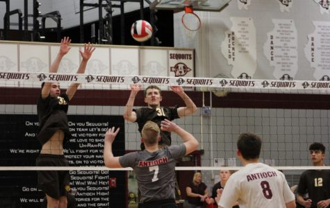 The Sequoits attempt to block the ball from Carmel.