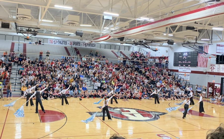 The Color Guard performed at the first pep rally of the year for ACHS. The theme was 1930s Chicago. The team used many props, such as sabres and fake guns.