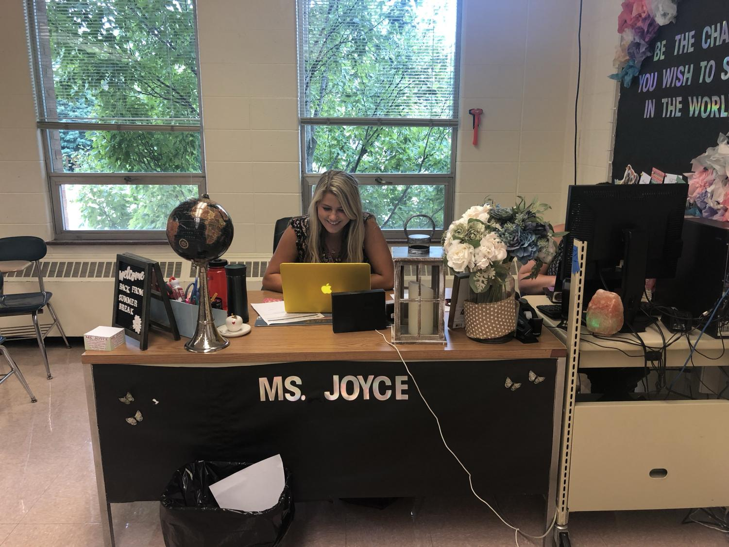 Joyce spends time during her off periods preparing for upcoming classes and meeting with other teachers. Her classroom is covered with student art and projects, and her desk is decorated as well. The overall environment of the classroom is very inviting for every student.