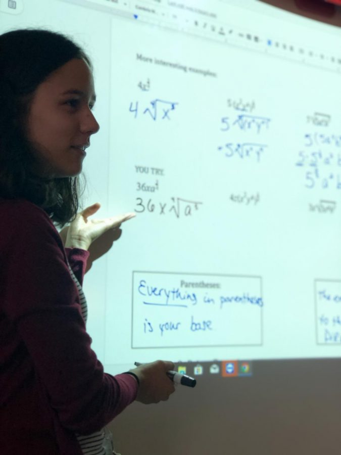 Elisa Metzger teaches her math II honors students how to simplify radicals during her fifth hour class.