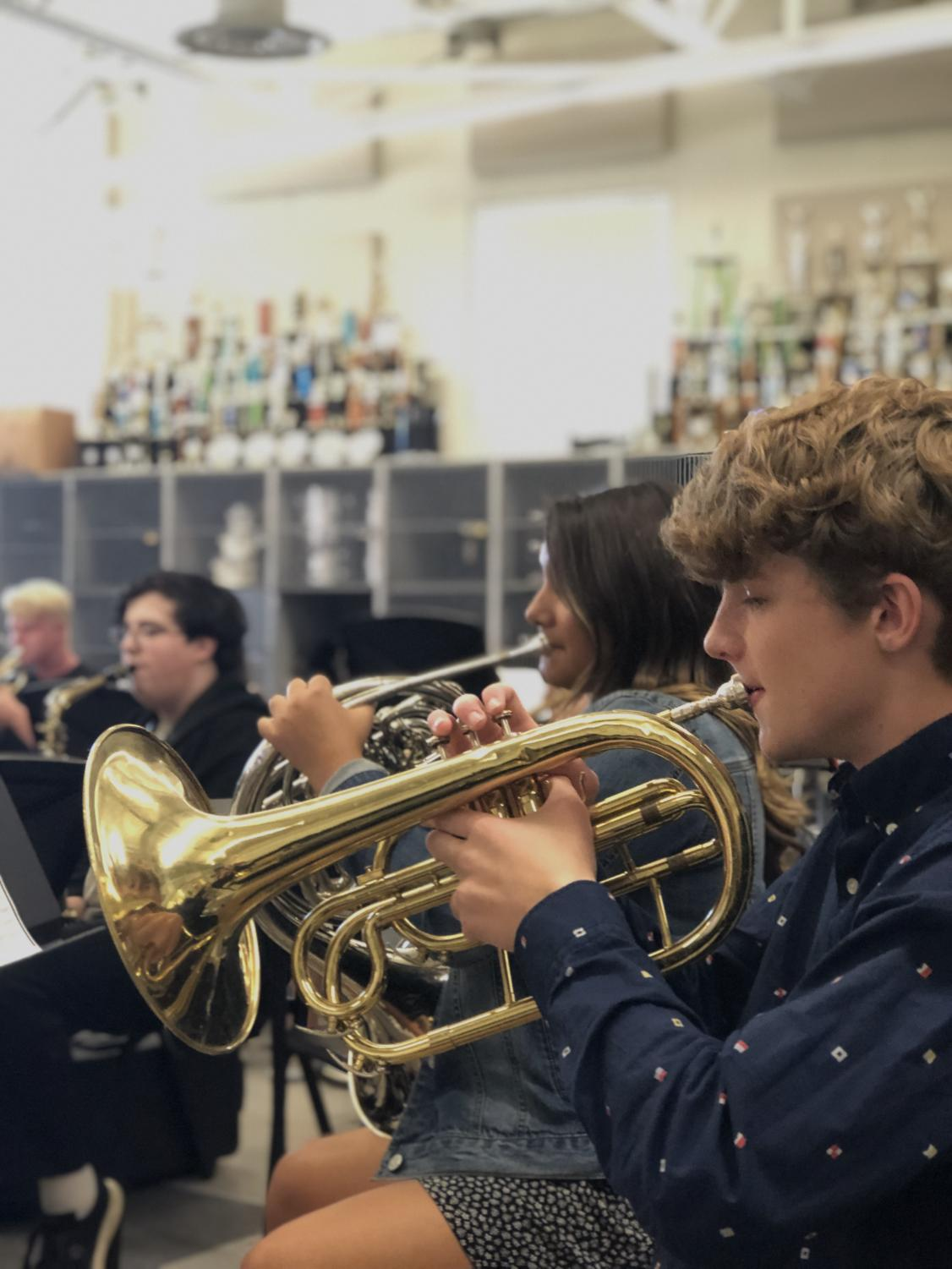Sophomores Mark Deutschmann and Delilah Hately are practicing their cornets to get ready for their upcoming performances.