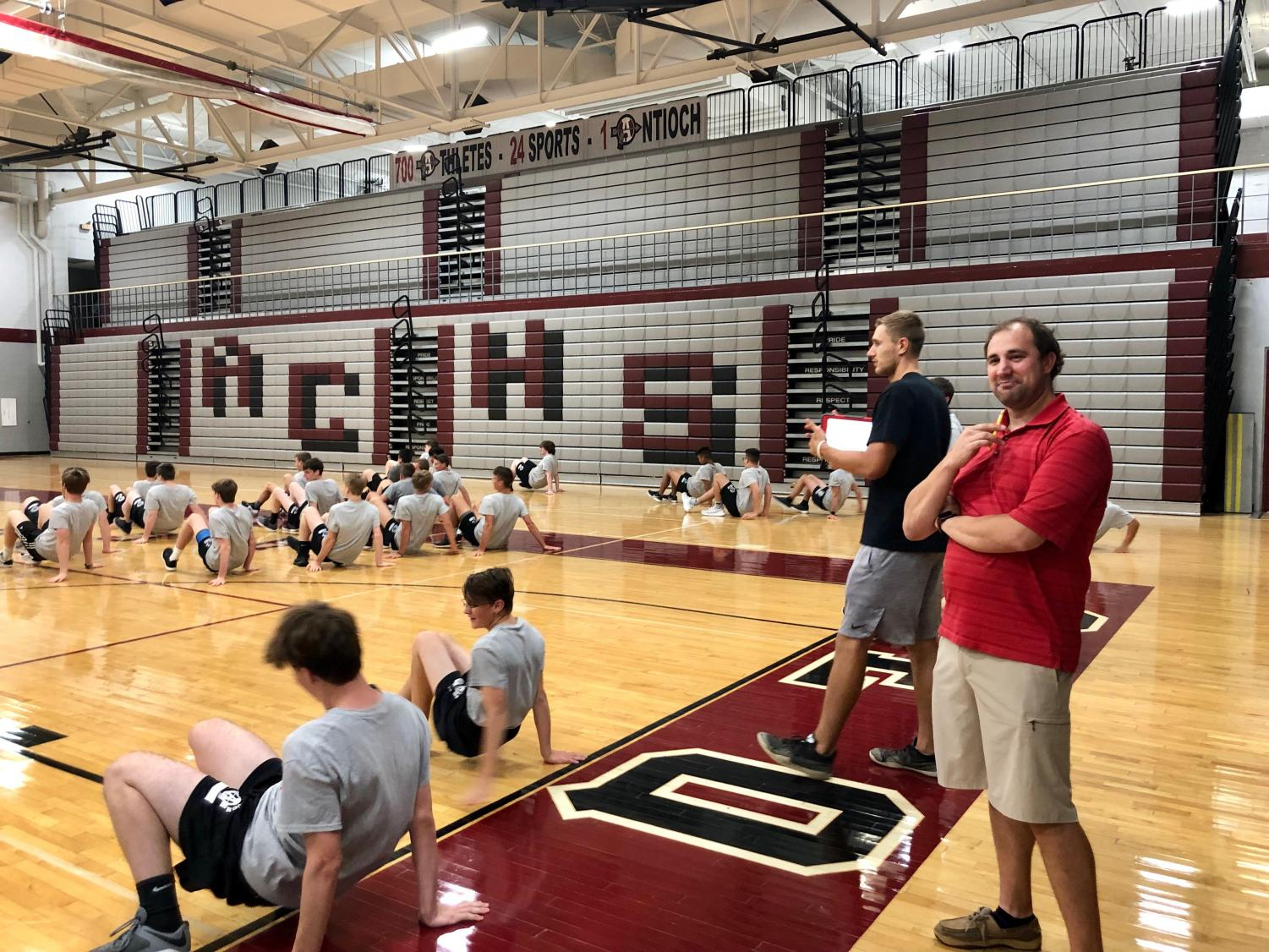 In his first semester of teaching at Antioch Community High School, Bryn Nottoli supervises a 6th hour Boy's Physical Best class as they warm-up before their daily workout.