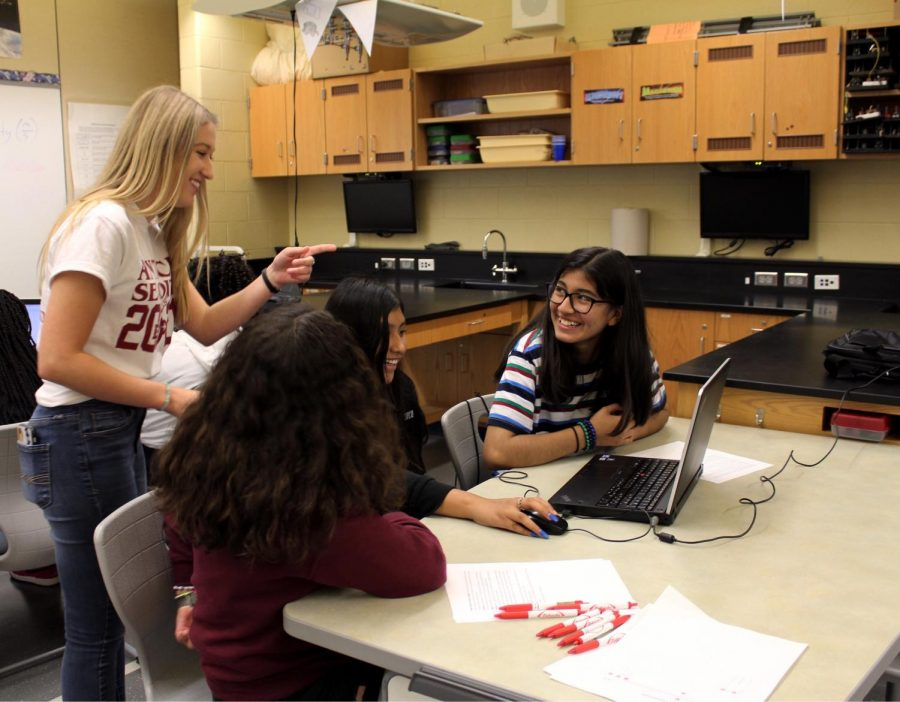 One of the classes the girls took part in was creating their own app. Junior Lindsey Lubicz volunteered and helped during the process.