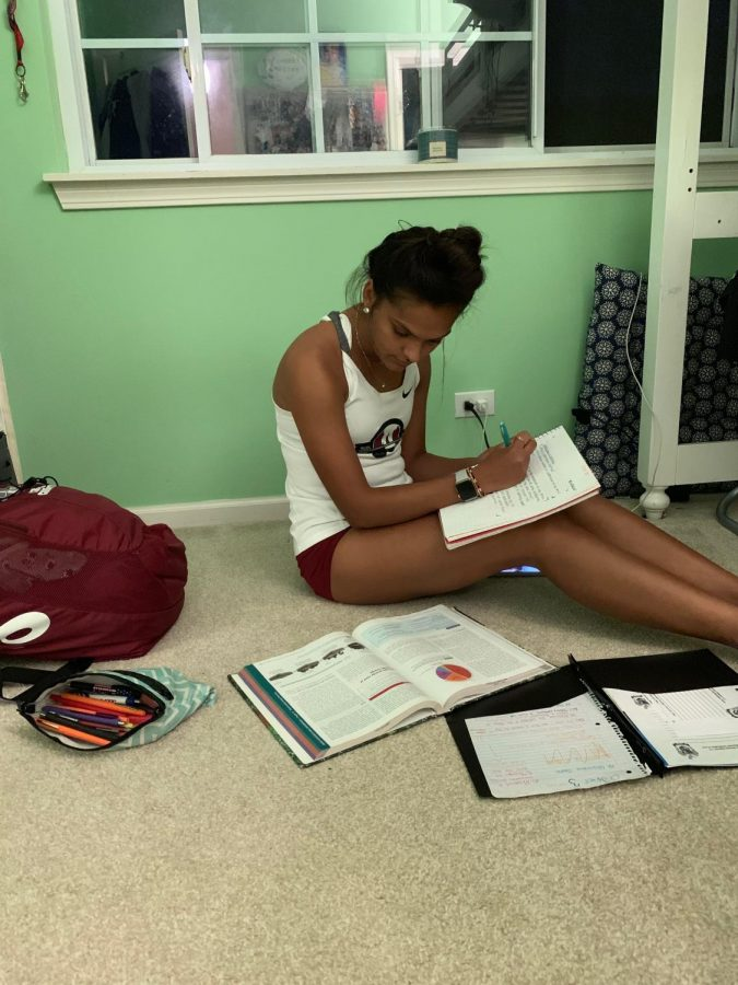 After spending multiple hours in the school and running miles in a cross country race, athletes use the remainder of their time doing homework.