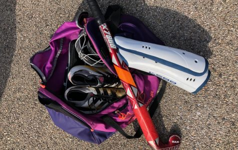 Senior Mikayla Holway shows the contents of her field hockey bag.