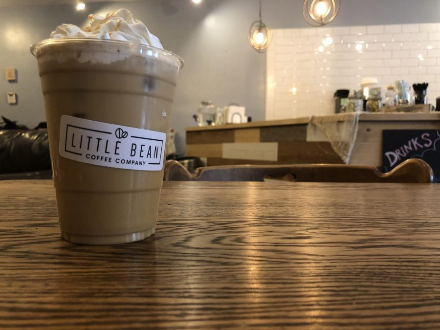 Changing the name of a business can be tough. Working to convert the old Cafe Book into Little Bean Coffee Company requires effort into rebranding, such as logo cups. Staff are spreading the new name in as many ways as possible, to make the transition smoother.