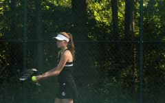 Seinor Jensen Horner gets ready to serve at the Lakes match Thursday September 26th.