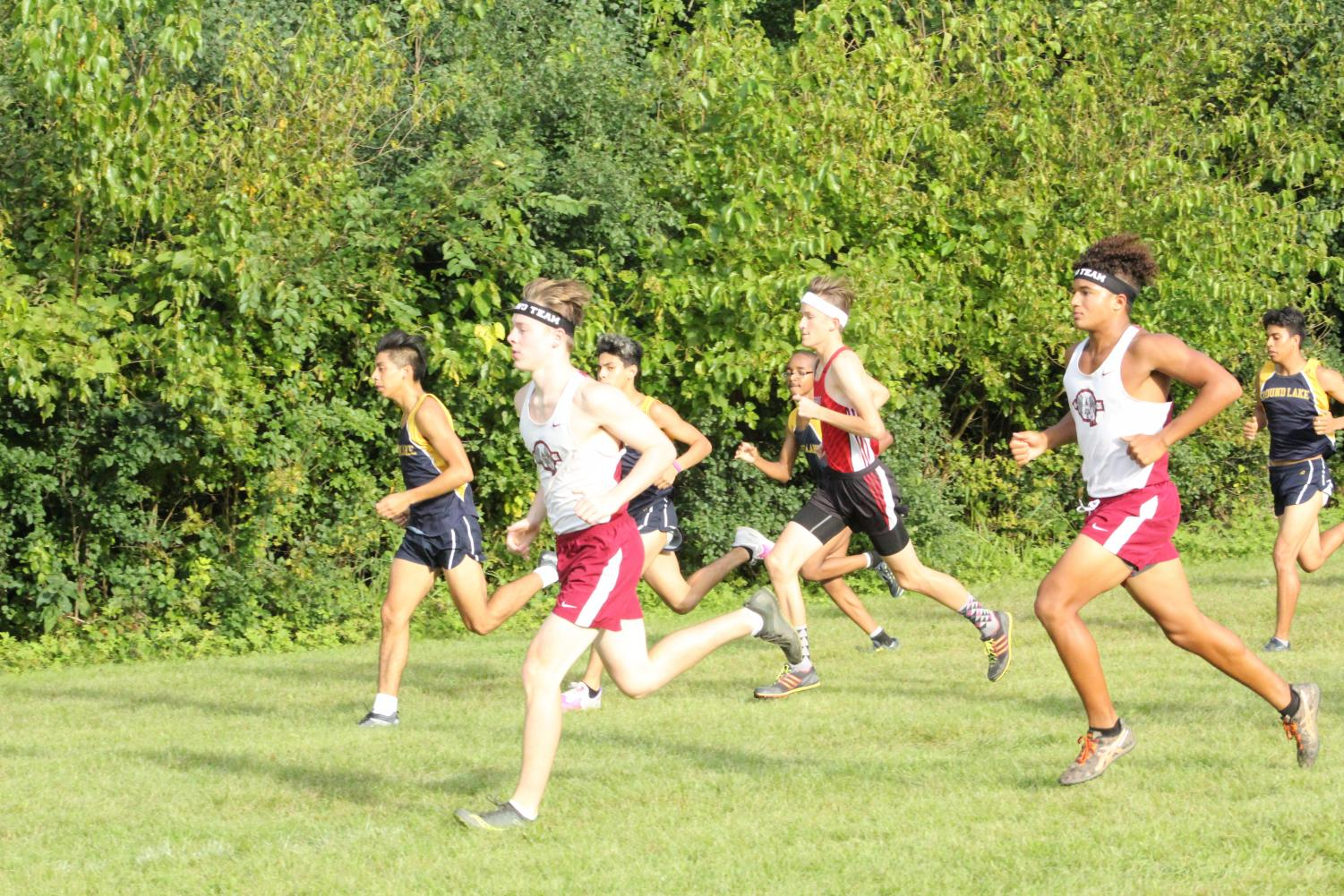 Juniors Owen Lane and Kyle Miller pushing through the last stretch of the race.