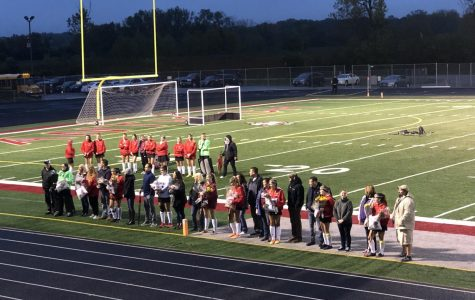 The team gathers during Senior Night to celebrate the Seniors' last year on the team. There are nine seniors in the Field Hockey program. They ended the night successfully with a win.