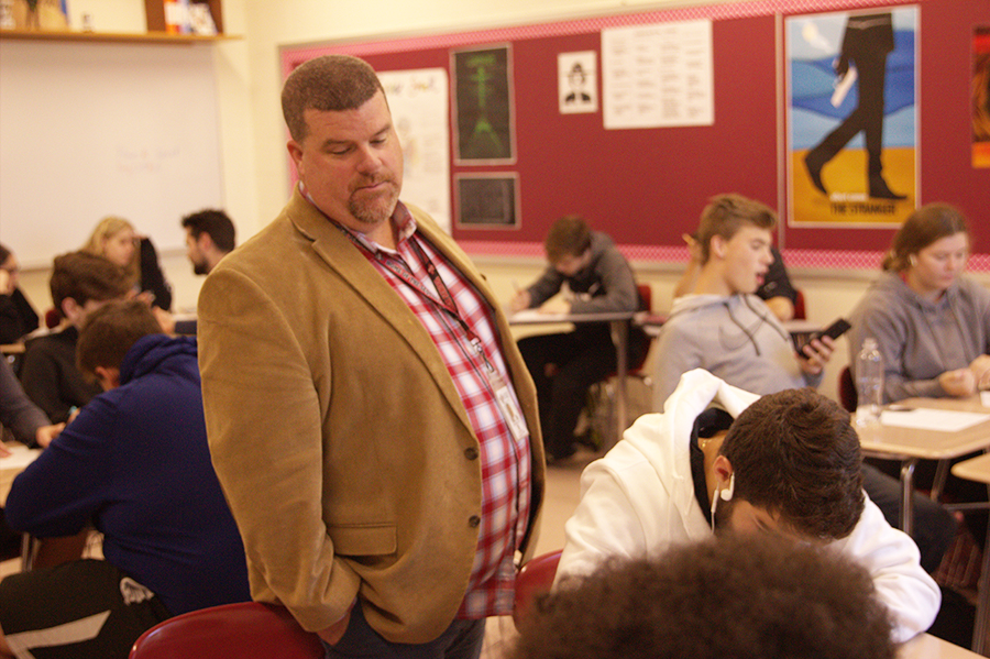 Principal Eric Hamilton observes a classroom as an effort to keep in touch with his students.