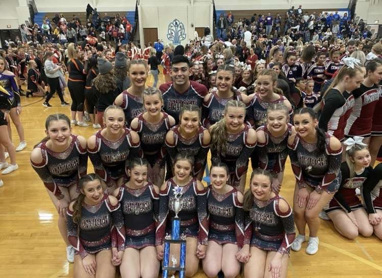 The Antioch varsity cheer team takes a picture with their second place trophy, that they won at Lake Zurich.