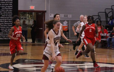 Junior Gianna Rifrogiato going in for a layup on a fast break in their previous win against North Chicago.