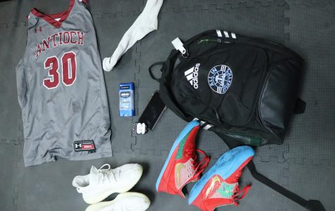 Krise includes his AirPods, basketball shoes and his lucky sock in his bag to help him perform his best during the basketball season.