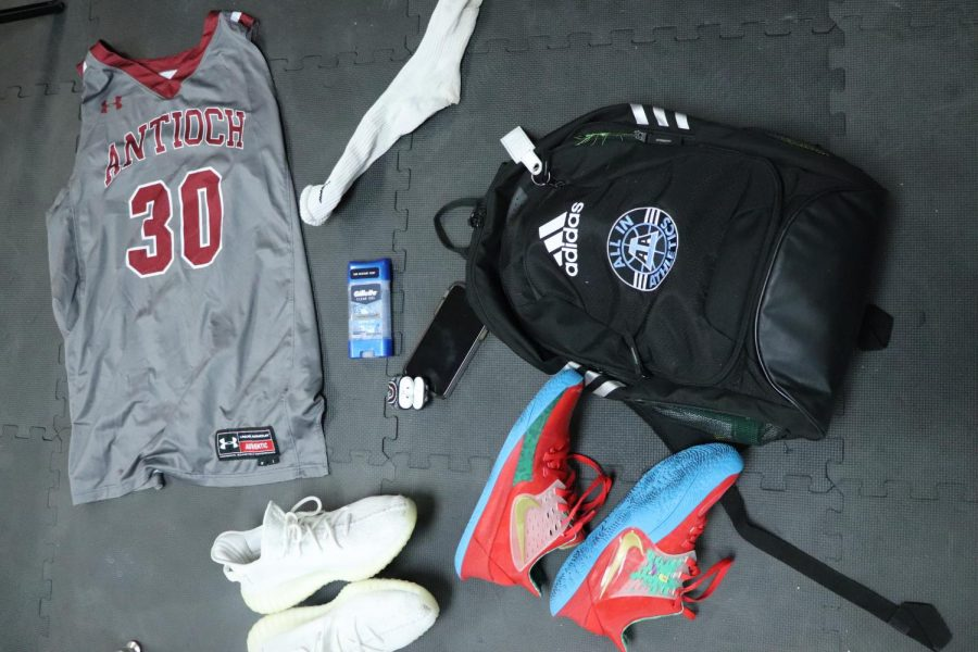 Krise+includes+his+AirPods%2C+basketball+shoes+and+his+lucky+sock+in+his+bag+to+help+him+perform+his+best+during+the+basketball+season.