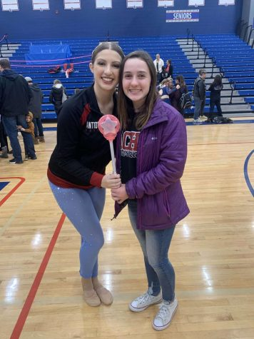 Junior Kelsi Sheren holds the spirit stick after an amazing competiton.
