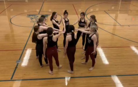 The Antioch varsity dance team huddling up to get ready to raise their energy at practice.