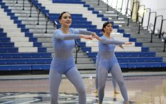 Junior captain Kara Galarneau and junior Maggie Quirke performing at Lake Zurich High School