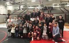 The varsity wrestling team celebrates their win at the Lake County Invitational.
