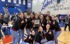 The dance team poses with their trophy after being crowned conference champions.