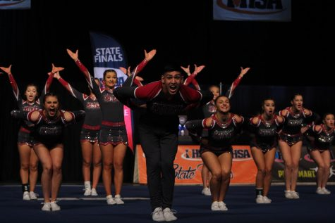 Starting their choreographed dance, senior Paul Valdivia-Valencia gives it his all at  the IHSA varsity cheerleading state championship.