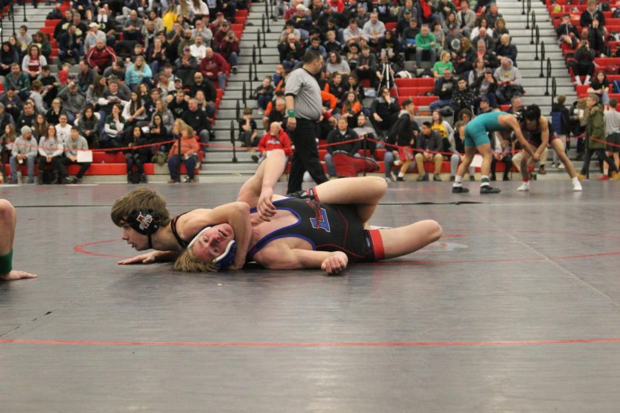 Luke Menzies takes out Lakes Community High Schools 126 varsity wrestler to move on to state.